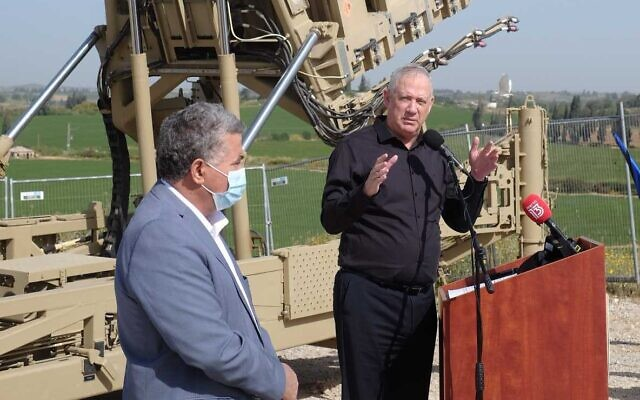 Defense Minister Benny Gantz speaks at a ceremony marking 10 years since the first Iron Dome interception at a missile battery in central Israel on April 7, 2021. (Judah Ari Gross/Times of Israel)