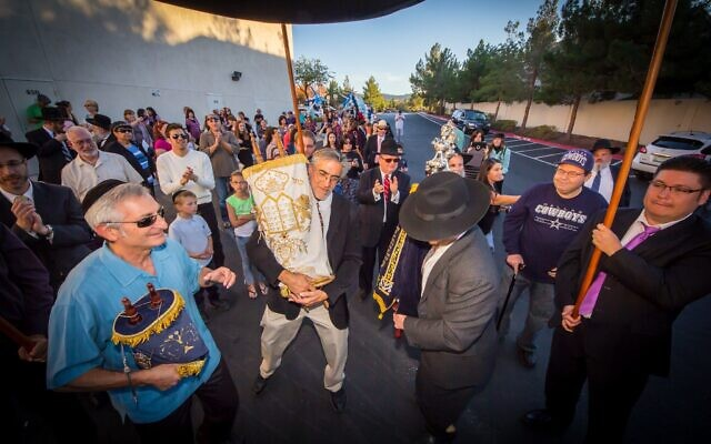 Members of the Ahavas Torah Center in Henderson parade through the city during a Torah dedication ceremony in the mid-2010s. The Las Vegas suburb is home to a growing Orthodox Jewish population. (Courtesy of Ahavas Torah Center/ via JTA)