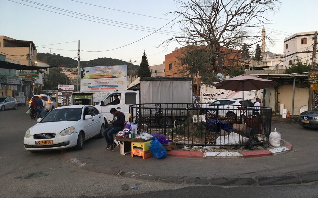 A small traffic circle is situated on the boundary between Israeli Bartaa and Palestinian Bartaa. (Uriel Heilman/ JTA)