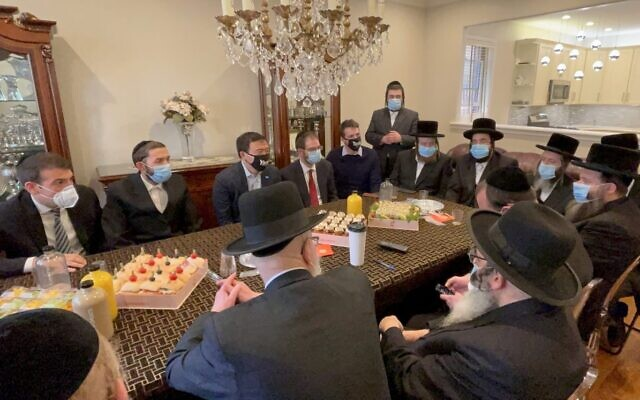 New York City mayoral candidate Andrew Yang, top, third from left, meets with haredi Orthodox Jewish leaders in Borough Park, Brooklyn, in an undated photo supplied by his campaign. (Yang for New York via JTA)
