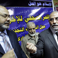 In this Sunday, May 5, 2010 file photo, Mahmoud Ezzat, a top Muslim Brotherhood leader, left, and Mohammed Badie, leader of Muslim Brotherhood leave a press conference in Cairo, Egypt. (AP Photo/Amr Nabil, File)
