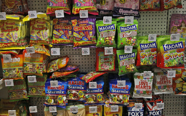 Sweets are on display at a shelf in a supermarket in London, Thursday, Aug. 18, 2016. (AP Photo/Frank Augstein)