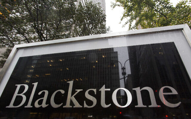 A sign for The Blackstone Group L.P. investment firm in front of its offices, October 15, 2018, in New York. (AP Photo/Mark Lennihan)