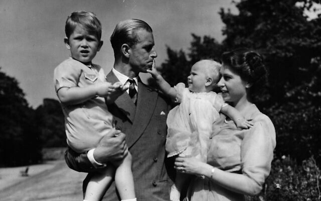 In this Aug. 1951 file photo, Princess Elizabeth stands with her husband the Duke of Edinburgh and their children Prince Charles and Princess Anne at the couple's London residence at Clarence House (AP Photo/Eddie Worth, file)
