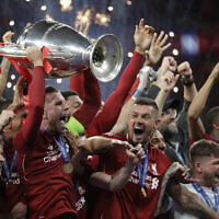 Liverpool's players celebrate with the trophy after winning the Champions League final soccer match between Tottenham Hotspur and Liverpool at the Wanda Metropolitano Stadium in Madrid on June 2, 2019. (AP Photo/Felipe Dana)