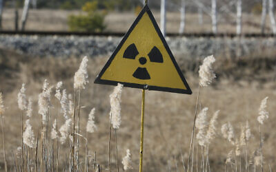 A radiation sign outside the deserted town of Pripyat, some 3 kilometers (1.86 miles) from the Chernobyl nuclear power plant in Ukraine, February 4, 2020. Once home to some 50,000 people whose lives were connected to the Chernobyl nuclear power plant, Pripyat was hastily evacuated one day after a plant reactor exploded on April 26, 1986. (AP Photo/Efrem Lukatsky)