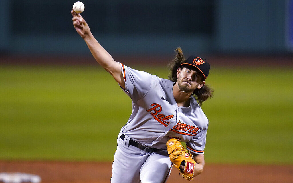 Baltimore Orioles starting pitcher Dean Kremer delivers during the first inning of the team's baseball game against the Boston Red Sox in Boston, September 23, 2020, at Fenway Park. (AP Photo/Charles Krupa)