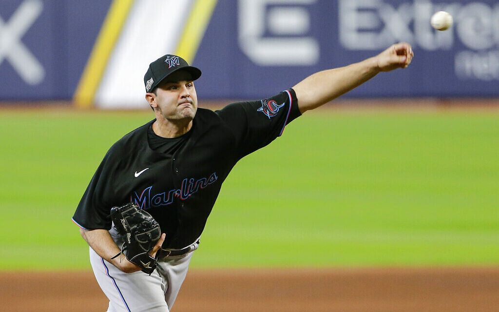 Miami Marlins' Richard Bleier delivers a pitch during the sixth inning in Game 2 of a baseball National League Division Series against the Atlanta Braves, October 7, 2020, in Houston. (AP Photo/Michael Wyke)