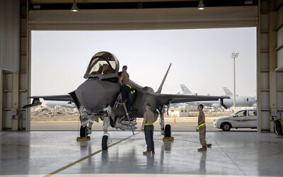 An F-35 fighter jet pilot and crew prepare for a mission at Al-Dhafra Air Base in the United Arab Emirates, August 5, 2019.  (Staff Sgt. Chris Thornbury/US Air Force via AP)
