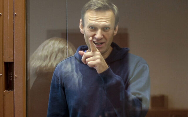 FILE: Russian opposition leader Alexei Navalny gestures during a hearing on his charges for defamation in the Babuskinsky District Court in Moscow, Russia, Feb. 16, 2021. (Babuskinsky District Court Press Service via AP)