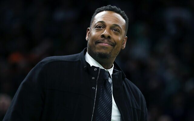 Former Boston Celtic Paul Pierce attends the NBA basketball game between the Celtics and the Houston Rockets in Boston, February 29, 2020. (AP Photo/Michael Dwyer, file)