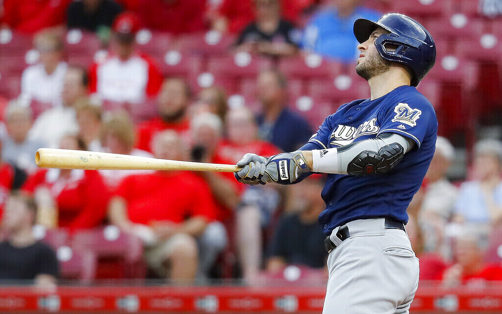 FILE - In this Sept. 25, 2019, file photo, Milwaukee Brewers' Ryan Braun watches his grand slam off Cincinnati Reds starting pitcher Tyler Mahle during the first inning of a baseball game in Cincinnati. (AP Photo/John Minchillo, File)