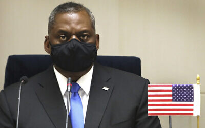 US Defense Secretary Lloyd Austin listens as his Indian counterpart reads out a press statement in New Delhi, India, March 20, 2021. (AP Photo/Manish Swarup)