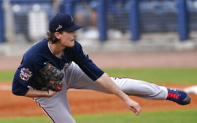Atlanta Braves starting pitcher Max Fried (54) works against the Tampa Bay Rays in a spring training baseball game, March 21, 2021, in Port Charlotte, Florida. (AP Photo/John Bazemore)