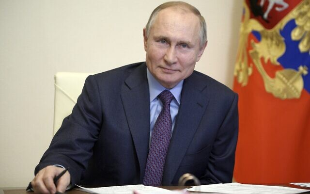 Russian President Vladimir Putin listens during a meeting with government officials via video conference at the Novo-Ogaryovo residence outside Moscow, Russia, March 22, 2021. (Alexei Druzhinin, Sputnik, Kremlin Pool Photo via AP)