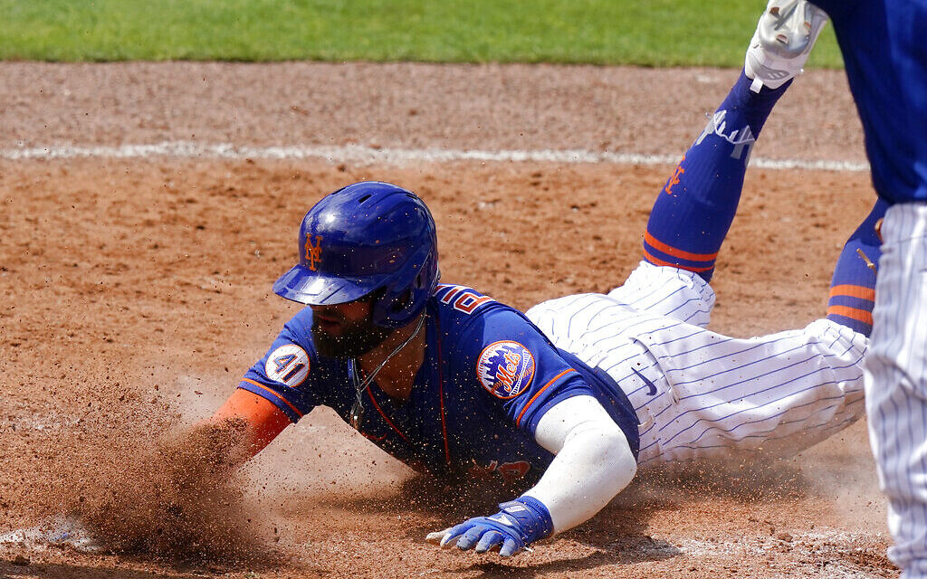 New York Mets' Kevin Pillar is out stealing home during the fourth inning of a spring training baseball game against the Miami Marlins, March 23, 2021, in Port St. Lucie, Florida. (AP Photo/Lynne Sladky)