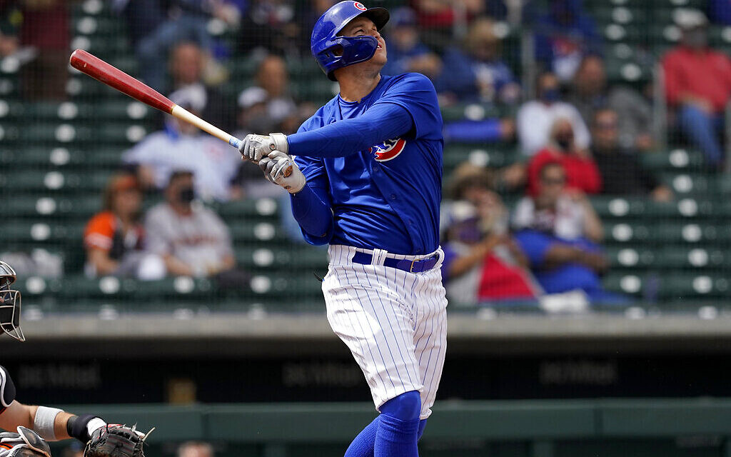 Chicago Cubs' Joc Pederson watches his two run home run take flight during the first inning of a spring training baseball game against the San Francisco Giants, March 26, 2021, in Mesa, Arizona. (AP Photo/Matt York)