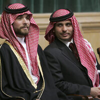 FILE - In this Nov. 28, 2006, file photo, Prince Hamzah Bin Al-Hussein, right, and Prince Hashem Bin Al-Hussein, left, half brothers of King Abdullah II of Jordan, attend the opening of the parliament in Amman, Jordan. (AP Photo/Mohammad abu Ghosh, File)