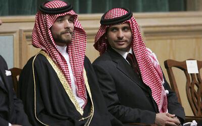 FILE - In this Nov. 28, 2006, file photo, Prince Hamzah Bin Al-Hussein, right, and Prince Hashem Bin Al-Hussein, left, half brothers of King Abdullah II of Jordan, attend the opening of the parliament in Amman, Jordan. (AP Photo/Mohammad abu Ghosh, File)