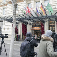 Journalists wait in front of the Grand Hotel Wien where closed-door nuclear talks with Iran take place in Vienna, Austria, Tuesday, April 6, 2021. (AP Photo/Florian Schroetter)