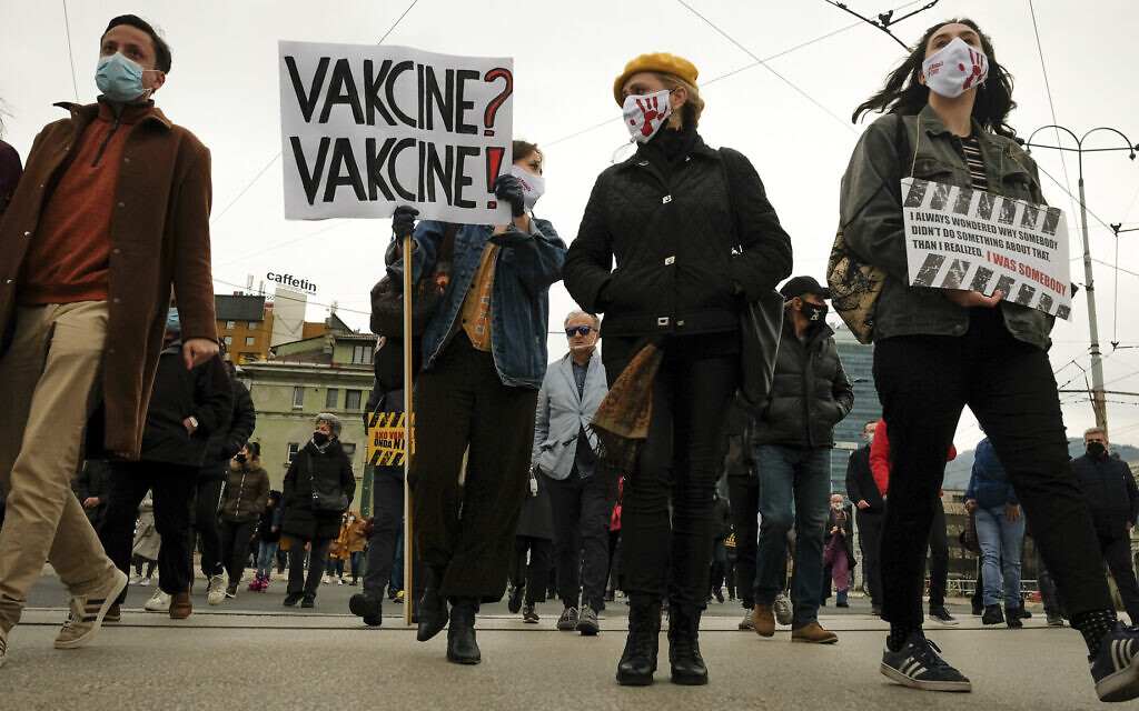 Protesters march demanding the resignation of the government over the poor handling of the coronavirus pandemic in Sarajevo, Bosnia, Tuesday, April 6, 2021. (AP Photo/Kemal Softic)