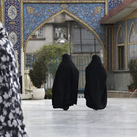 Head-to-toe veiled Iranian women walk at the shrine of Saint Saleh in northern Tehran, Iran, April 6, 2021 (Vahid Salemi/AP)