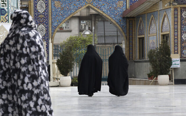 Head-to-toe veiled Iranian women walk at the shrine of Saint Saleh in northern Tehran, Iran, April 6, 2021 (Vahid Salemi/AP)