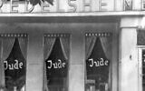 FILE -  In this June 19, 1938 file picture, the word Jude (jew) is smeared to the windows of a shop in Berlin run by Jews.  (AP Photo, file)