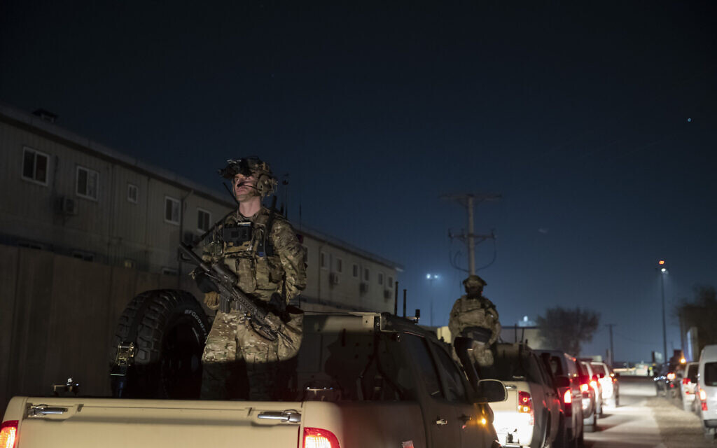 In this November 28, 2019, file photo armed soldiers stand guard in the motorcade for US President Donald Trump speaks during a surprise Thanksgiving Day visit to the troops at Bagram Air Field, Afghanistan. (AP/Alex Brandon, File)