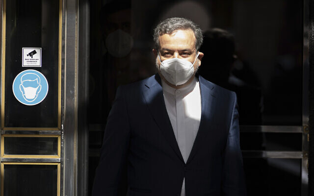 Political deputy at the Ministry of Foreign Affairs of Iran, Abbas Araghchi, leaves the 'Grand Hotel Wien' where closed-door nuclear talks with Iran take place in Vienna, Austria, April 9, 2021. (AP Photo/Florian Schroetter)