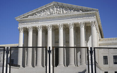 In this March 21, 2021, file photo security fencing surrounds the Supreme Court building on Capitol Hill in Washington. (AP/Patrick Semansky, File)