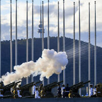 The Australian Federation Guard fire a 41 gun salute to mark the passing of Prince Philip on the forecourt of Parliament House, in Canberra, Australia, Saturday, April 10, 2021. (Lukas Coch/AAP Image via AP)