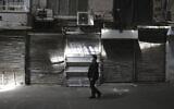 A man walks through Tehran's closed Grand Bazaar, in Tehran, Iran, April 10, 2021. (AP /Vahid Salemi)