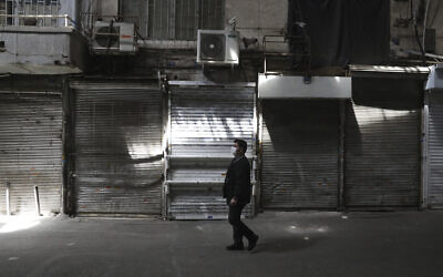 A man walks through Tehran's closed Grand Bazaar, in Tehran, Iran, April 10, 2021. (AP /Vahid Salemi)