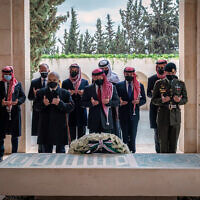 This photo from the Royal Court twitter account, shows Jordan's King Abdullah II, center, Prince Hamzah bin Al Hussein, second left, and others during a visit to the tomb of the late King Hussein. Members of the Jordanian royal family Sunday marked the centenary of the establishment of the Emirate of Transjordan, a British protectorate that preceded the kingdom. (Royal Court Twitter Account via AP)