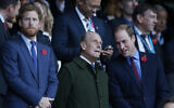 Britain's Prince Harry, left, and his brother Prince William, right, stand with their grandfather the Duke of Edinburgh as they wait for the start of the Rugby World Cup final between New Zealand and Australia at Twickenham Stadium, London, October 31, 2015. (AP Photo/Alastair Grant, File)