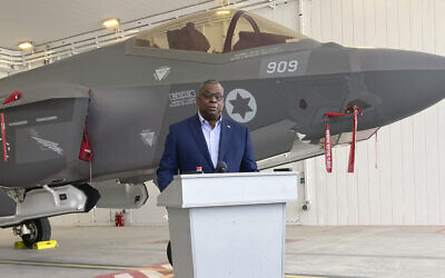 US Defense Secretary Lloyd Austin speaks to reporters at Israel's Nevatim air base Monday, with an Israeli F-35 fighter jet in the background, on Monday, April 12, 2021 in Israel. (AP Photo/Robert Burns)