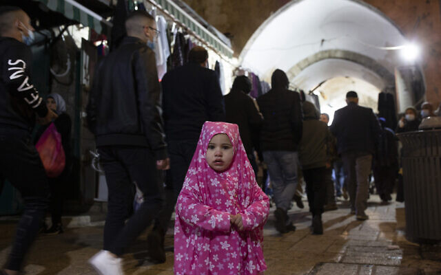 A Palestinian toddler wears a jilbab, an Islamic garment, on the eve of the Muslim holy month of Ramadan in the Old City of Jerusalem, April 12, 2021. (AP Photo/Maya Alleruzzo)