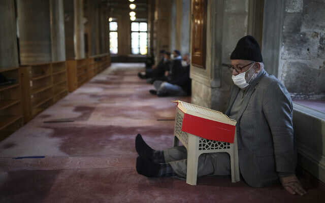 People pray at the Eyup Sultan Mosque, in Istanbul, April 12, 2021, a day before Ramadan. (AP Photo/Emrah Gurel)