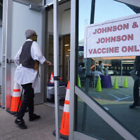 In this April 1, 2021 photo, people walk in to get their COVID-19 vaccine at the Baldwin Hills Crenshaw Plaza in Los Angeles. (AP Photo/Damian Dovarganes)