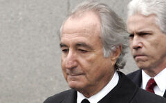 In this March 10, 2009, file photo, former financier Bernie Madoff leaves federal court in Manhattan, in New York. (AP Photo/David Karp, File)