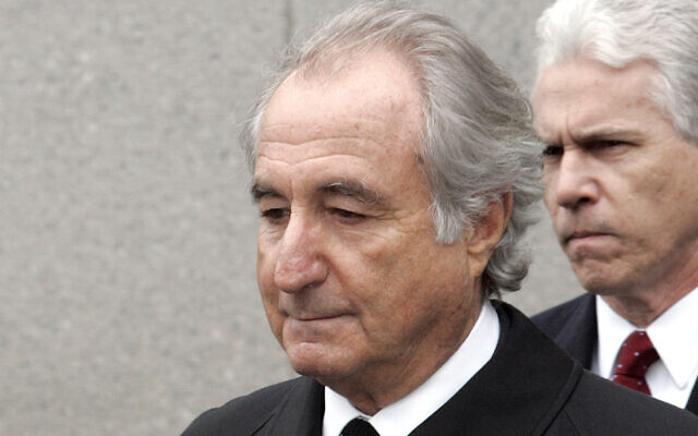 In this March 10, 2009, file photo, former financier Bernie Madoff leaves federal court in Manhattan, in New York. (AP Photo/David Karp, File)
