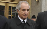Bernard Madoff exits Manhattan federal court in New York, March 10, 2009. (AP Photo/ Louis Lanzano, File)