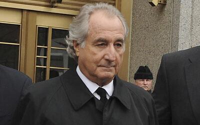 Bernard Madoff exits Manhattan federal court in New York, March 10, 2009. (AP Photo/ Louis Lanzano, File)
