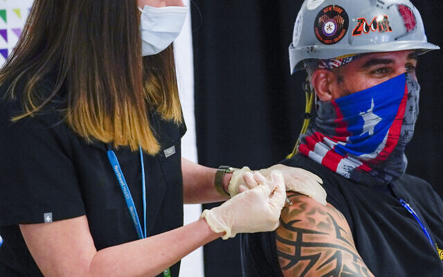 Illustrative: A nurse inoculates Local 28 Sheet Metal Worker Demetrius Buttelman with the first dose of the Pfizer vaccine during a news conference at the Belmont Park in Elmont, New York, April 14, 2021. (AP Photo/Mary Altaffer, Pool, File)
