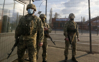 Ukrainian soldiers guard a check point at the town Shshastya, Ukraine, near Luhansk, Ukraine, April 16, 2021. (Efrem Lukatsky/AP)
