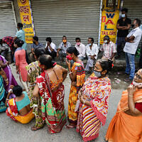 Voters  wait to cast their votes during the fifth phase of West Bengal state elections in Newtown Rajarhat, North 24 Parganas district, India, April 17, 2021. (Bikas Das/AP)