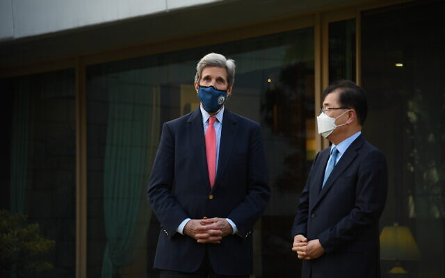 In this photo provided by the US Embassy in Seoul, US Special Presidential Envoy for Climate John Kerry, left, talks with South Korean Foreign Minister Chung Eui-yong upon his arrival for the banquet at the Foreign Minister's residence in Seoul, South Korea on April 17, 2021. (US Embassy Seoul via AP)