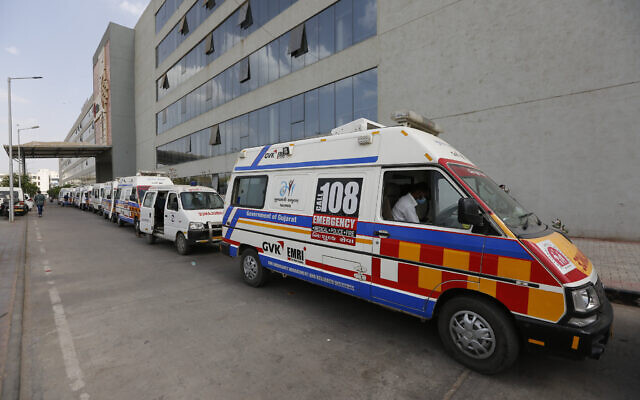 Ambulances carrying COVID-19 patients queue up waiting for their turn to be attended at a dedicated COVID-19 government hospital in Ahmedabad, India, April 17, 2021. (Ajit Solanki/AP)