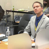 In this image from video, former Minneapolis police Officer Derek Chauvin listens as his defense attorney Eric Nelson gives closing arguments as Hennepin County Judge Peter Cahill preside on April 19, 2021, in the trial of Chauvin at the Hennepin County Courthouse in Minneapolis. (Court TV via AP, Pool)